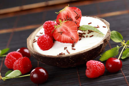 Photo for Coconut ice cream with fresh fruits - Royalty Free Image
