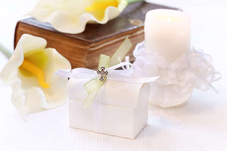 First holy communion or confirmation - candle, open bible and small present