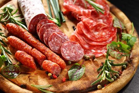 Foto de Different Italian ham and salami with herbs - Imagen libre de derechos