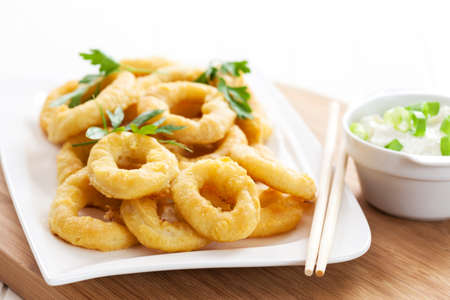 Fried calamari rings with yogurt garlic dip