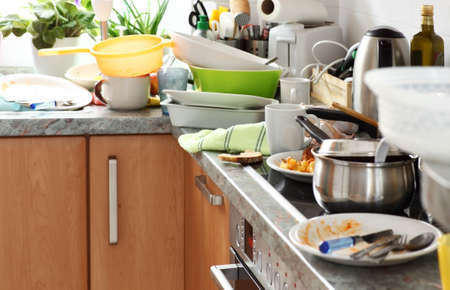 Photo pour Pile of dirty dishes in the kitchen - Compulsive Hoarding Syndrom - image libre de droit