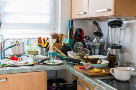 Photo pour Compulsive Hoarding Syndrom - messy kitchen with pile of dirty dishes - image libre de droit