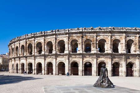 Nimes, France - March 21 2019: The Place des ArÚnes (English: bullring square) with the ArÚnes de Nîmes.