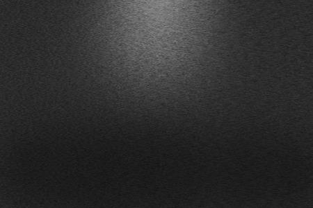 Foto de Pattern of brushed black metal background. Subdued light is in the upper middle part of the background. - Imagen libre de derechos