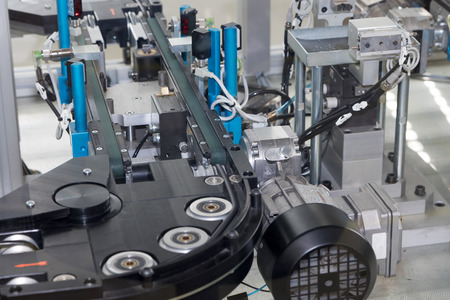 Detailed view of an empty assembly line for the production of plastic components. Horizontally. All potential trademarks are removed.