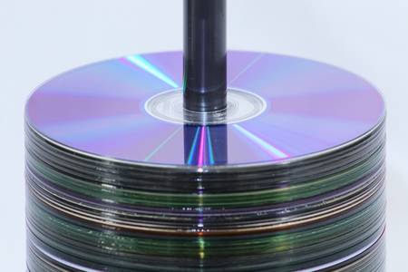 Spool of CD's stacked in the center of the frame
