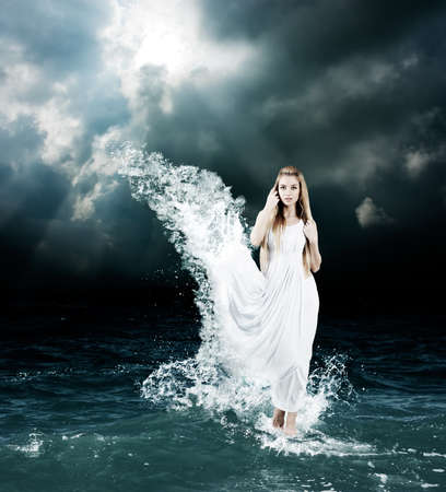 Photo for Woman in Splashing Dress Walking on Stormy Sea. Aphrodite Godess Collage. - Royalty Free Image