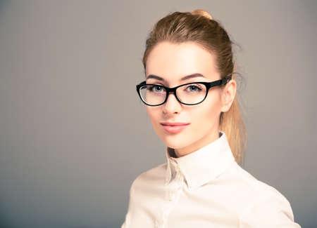 Photo pour Portrait of Beautiful Business Woman Wearing White Shirt and Glasses - image libre de droit