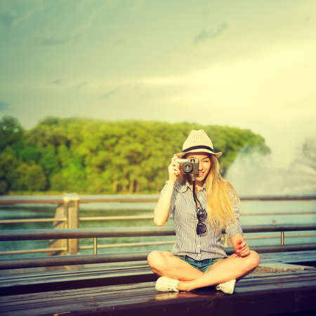 Photo pour Portrait of Young Hipster Girl Making Photo with Vintage Camera. Modern Youth Lifestyle Concept.  - image libre de droit