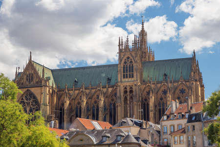Photo for St. Stephen Cathedral emerging from behind some houses in Metz - Royalty Free Image