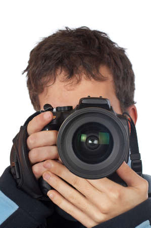 Teenager photographer holding and looking into a camera