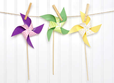 Vibrant Summer Party Pinwheels on a Clothesline with White Background.