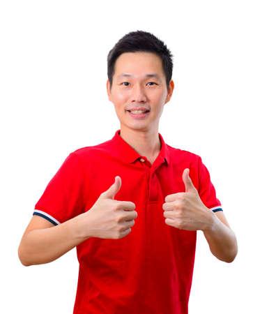 Foto de Portrait handsome asian man giving double thumb up on white background - Imagen libre de derechos