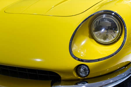 Bologna, BO, Italy - October 24, 2015: Detail of luxury sporty car duinng a vintage rally in Bologna  -- Body parts of a luxury sports car of yellow color