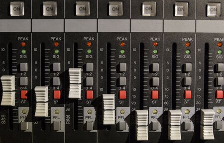 Foto per Front view of electronic mixer used to create music from a dj - Immagine Royalty Free