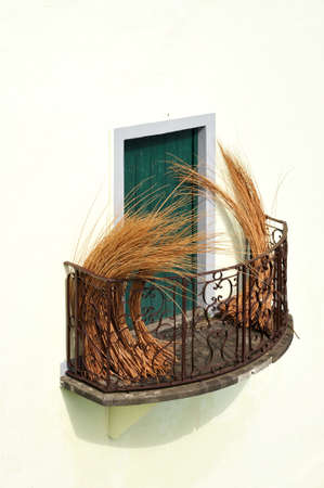 Balcony at old house in Madeira with package of wicker