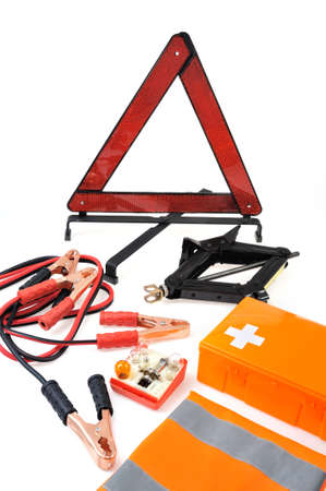 Emergency kit for car - first aid kit, car jack, jumper cables, warning triangle, light bulb kit