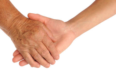 Photo pour  Hands of young and senior women - helping hand concept - clipping path included - image libre de droit