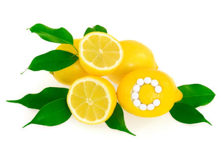 Lemons with vitamin c pills over white background –concept