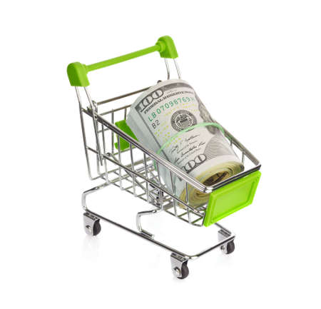Shopping cart with dollars. Isolated on white background