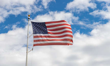 Photo pour A picture of an American flag waving in the air. - image libre de droit