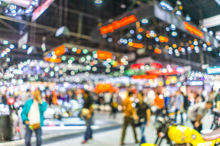 Foto de Abstract blurred background image with bokeh light of crowd people at cars exhibition show - Imagen libre de derechos