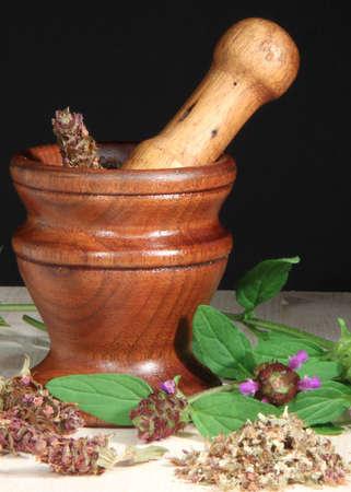 Mortar and Pestle with Selfheal (Prunella vulgaris) herb
