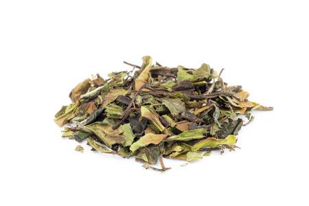 Heap of loose green leaves of white tea bai mu dan isolated on white background