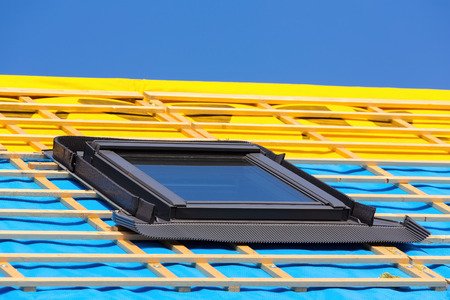 Photo pour One closed new skylight on the roof of a new home - image libre de droit