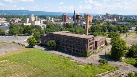 Photo for Aerial view of the skyline in Wilkes-Barre, Pennsylvania. A long-abandoned factory is in the foreground. - Royalty Free Image