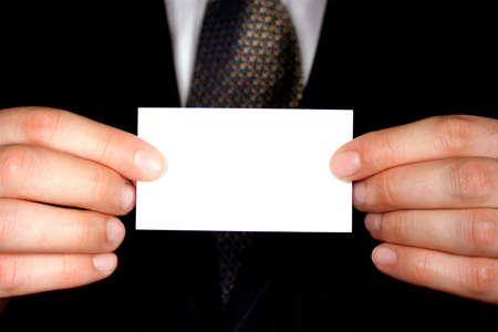 Photo pour A businessman holding up a blank businesscard - add your own text. - image libre de droit