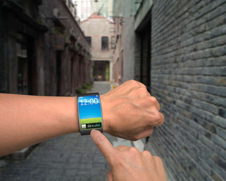 Photo pour hand wear smart watch with finger touching in street  - image libre de droit