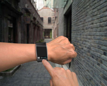 Photo pour male hand wear iwatch with an index finger on street background - image libre de droit