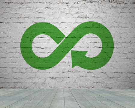 Photo pour Green circular economy concept. Arrow infinity symbol with grass on brick wall. - image libre de droit