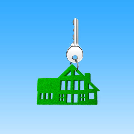 Photo pour Buying green energy house concept. Silver key with green grass house shape keyring, on sky background. - image libre de droit