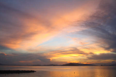 Photo pour Seascape at sunset. Lighthouse on the coast. Seaside town of Turgutreis and spectacular sunsets - image libre de droit