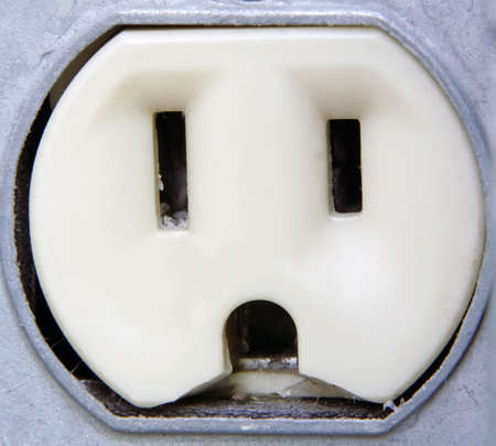 Extreme Closeup of an outdoor metal electrical outlet.