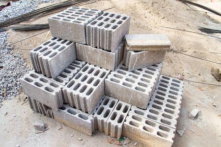 Bricks made of concrete for building of houses and fences.