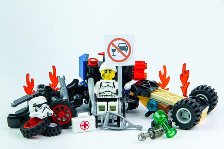 Nonthabure, Thailand - August, 08, 2016 : Lego star wars accident by a drunk driver. holding a sign Drink dont drive isolated on white background.Lego is an interlocking brick system collected around the world.