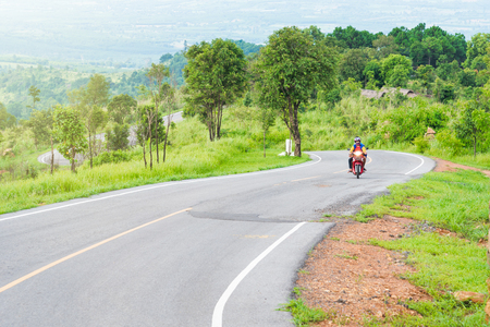 Chaiyaphum, Thailand - July, 01, 2017 : A view of motorcycle on a road in Phu Laen Kha National Park at Chaiyaphum, Thailand