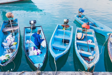 Photo pour Phuket, Thailand - March, 30, 2019 : Small boats moored in morning time at Chalong port, Main port for travel ship to krabi and phi phi island, Phuket, Thailand - image libre de droit