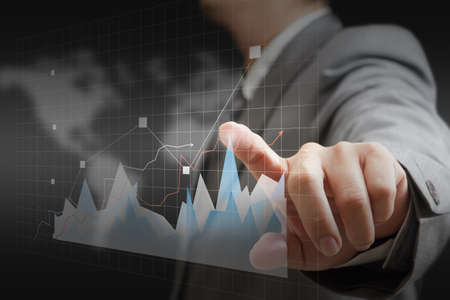 businessman hand touch virtual graph,chart, diagram on wold background