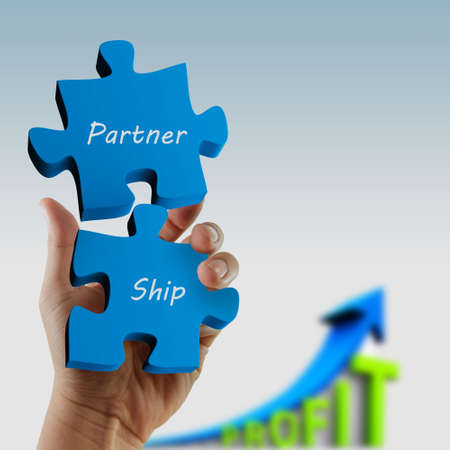 partnership  written puzzle pieces in hand