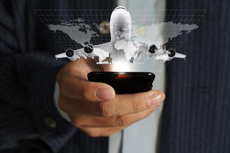 Foto de business man hand use mobile phone streaming travel around the world - Imagen libre de derechos
