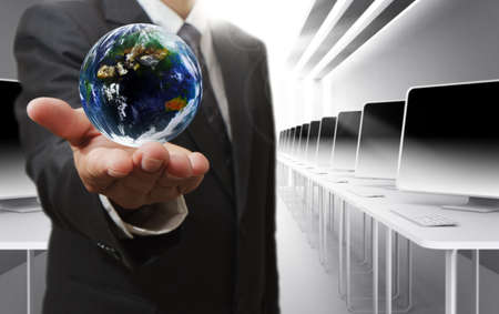 Business man hand holds globe and social network Elements of this image furnished by NASA の写真素材