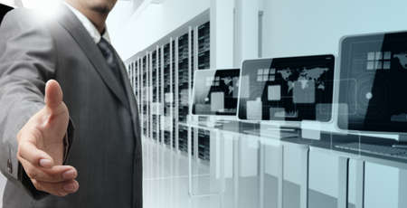 Foto de business man offers hand shake in computer center - Imagen libre de derechos