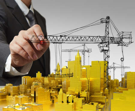 business man hand draws golden building development concept