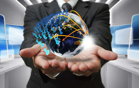 Business man hand holds globe and social networkの写真素材