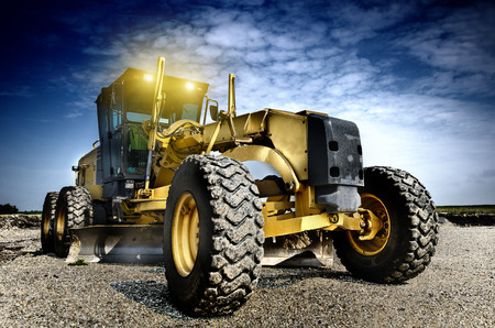 Photo for Grader is working on the road construction - Royalty Free Image