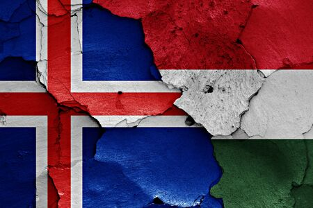 flags of Iceland and Hungary painted on cracked wall